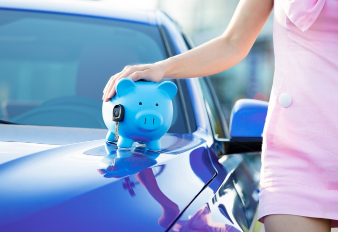 woman new car, piggy bank, key on hood